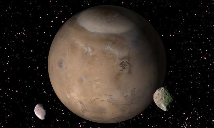 «Хаббл» заснял движение крошечного спутника по орбите Марса